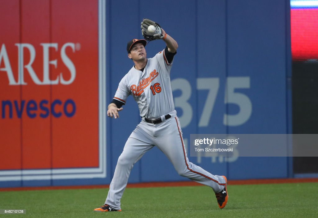 Trey Mancini #16 of the Baltimore Orioles catches a fly ball in the first inning during MLB game action against the Toronto Blue Jays at Rogers Centre on September 12, 2017 in Toronto, Canada.