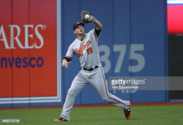 Trey Mancini of the Baltimore Orioles catches a fly ball in the first inning during MLB game action against the Toronto Blue Jays at Rogers Centre on...