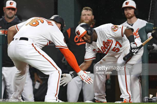 Trey Mancini of the Baltimore Orioles celebrates after hitting a home run against the Oakland Athletics during the first inning at Oriole Park at...