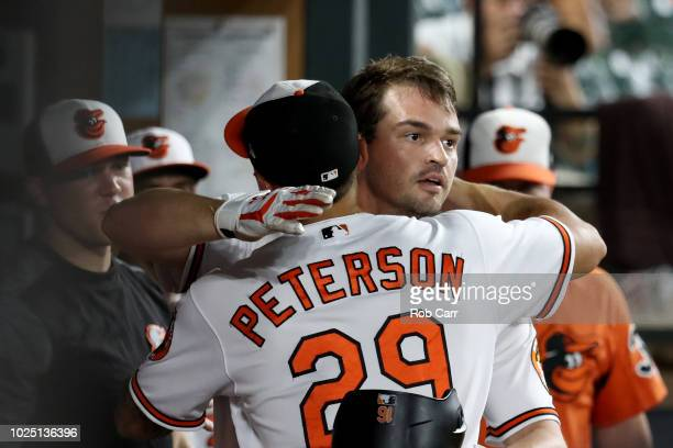 Trey Mancini of the Baltimore Orioles celebrates his solo home run in the fourth inning with teammate Jace Peterson against the Toronto Blue Jays at...
