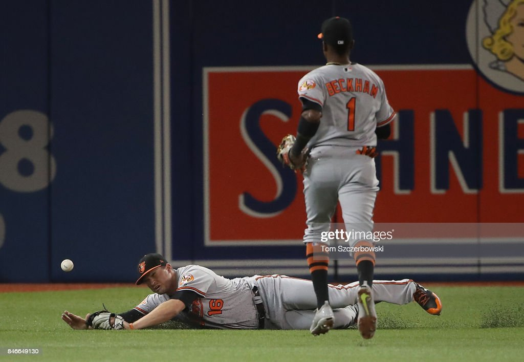 Trey Mancini #16 of the Baltimore Orioles dives but cannot get to an RBI single by Richard Urena #7 of the Toronto Blue Jays in the third inning during MLB game action at Rogers Centre on September 13, 2017 in Toronto, Canada.