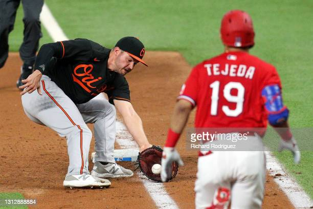 Trey Mancini of the Baltimore Orioles fields a ground ball hit by Anderson Tejeda of the Texas Rangers in the fifth inning at Globe Life Field on...