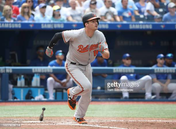 Trey Mancini of the Baltimore Orioles flies out in the eighth inning during MLB game action against the Toronto Blue Jays at Rogers Centre on August...