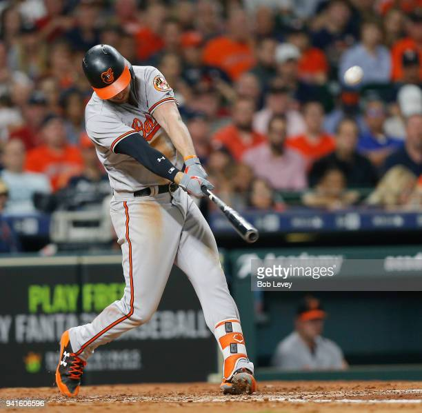 Trey Mancini of the Baltimore Orioles flies out to right field in the third inning against the Houston Astros at Minute Maid Park on April 3 2018 in...