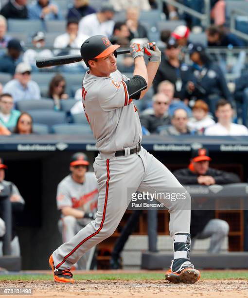 Trey Mancini of the Baltimore Orioles follows through on a hit during an MLB baseball game against the New York Yankees on April 30 2017 at Yankee...