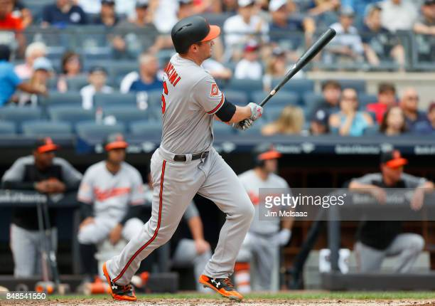 Trey Mancini of the Baltimore Orioles follows through on a third inning RBI double against the New York Yankees at Yankee Stadium on September 17...