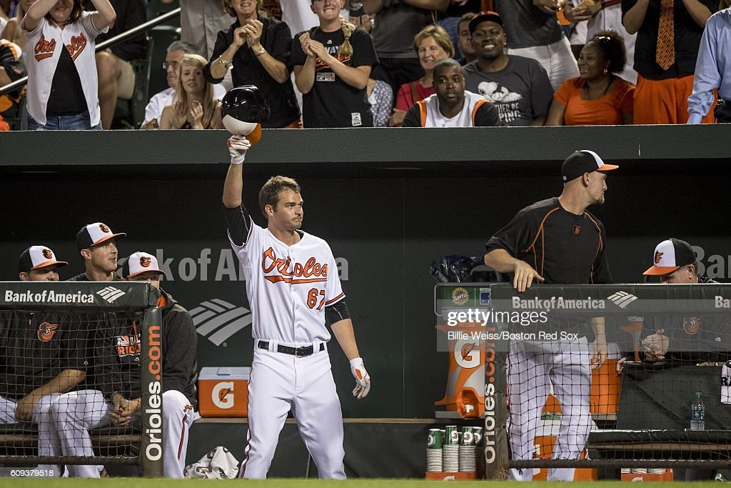 Trey Mancini #67 of the Baltimore Orioles gives a curtain call after hitting his first major league home run in his major league debut during the fifth inning of a game against the Boston Red Sox on September 20, 2016 at Oriole Park at Camden Yards in Baltimore, Maryland.