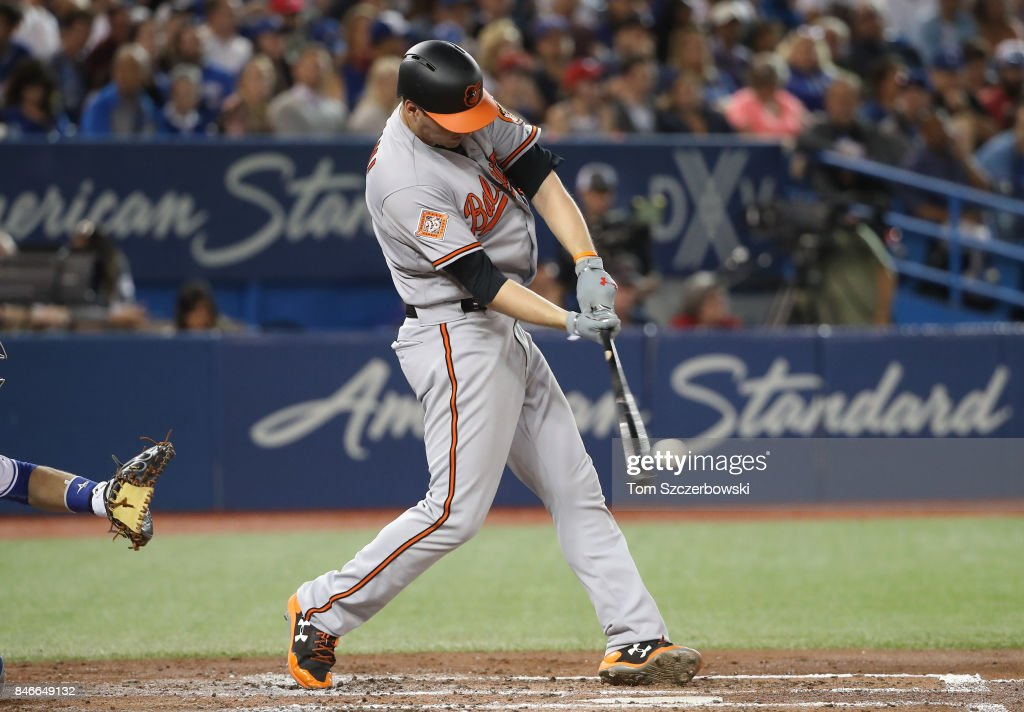 Trey Mancini #16 of the Baltimore Orioles hits a double in the fourth inning during MLB game action against the Toronto Blue Jays at Rogers Centre on September 13, 2017 in Toronto, Canada.