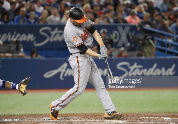 Trey Mancini of the Baltimore Orioles hits a double in the fourth inning during MLB game action against the Toronto Blue Jays at Rogers Centre on...