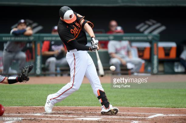 Trey Mancini of the Baltimore Orioles hits a home run in the first inning against the Washington Nationals at Oriole Park at Camden Yards on July 25,...