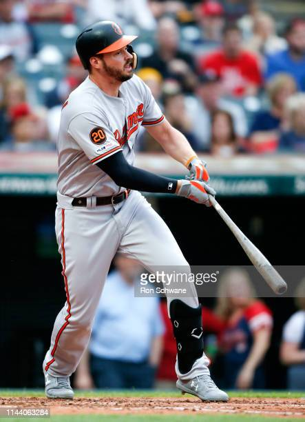 Trey Mancini of the Baltimore Orioles hits a three run home run off Trevor Bauer of the Cleveland Indians during the third inning at Progressive...