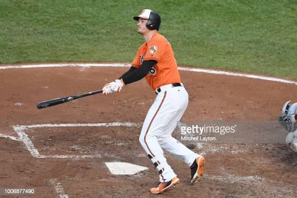 Trey Mancini of the Baltimore Orioles hits a two run home run in the second inning during a baseball game against the Tampa Bay Rays at Oriole Park...