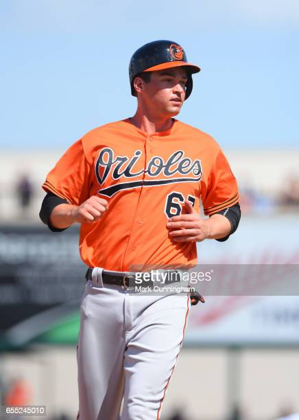 Trey Mancini of the Baltimore Orioles looks on during the Spring Training game against the Detroit Tigers at Publix Field at Joker Marchant Stadium...