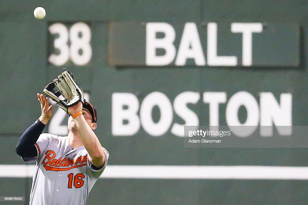 Trey Mancini #16 of the Baltimore Orioles makes a catch in the eighth inning of a game against the Boston Red Sox at Fenway Park on May 17, 2018 in Boston, Massachusetts.
