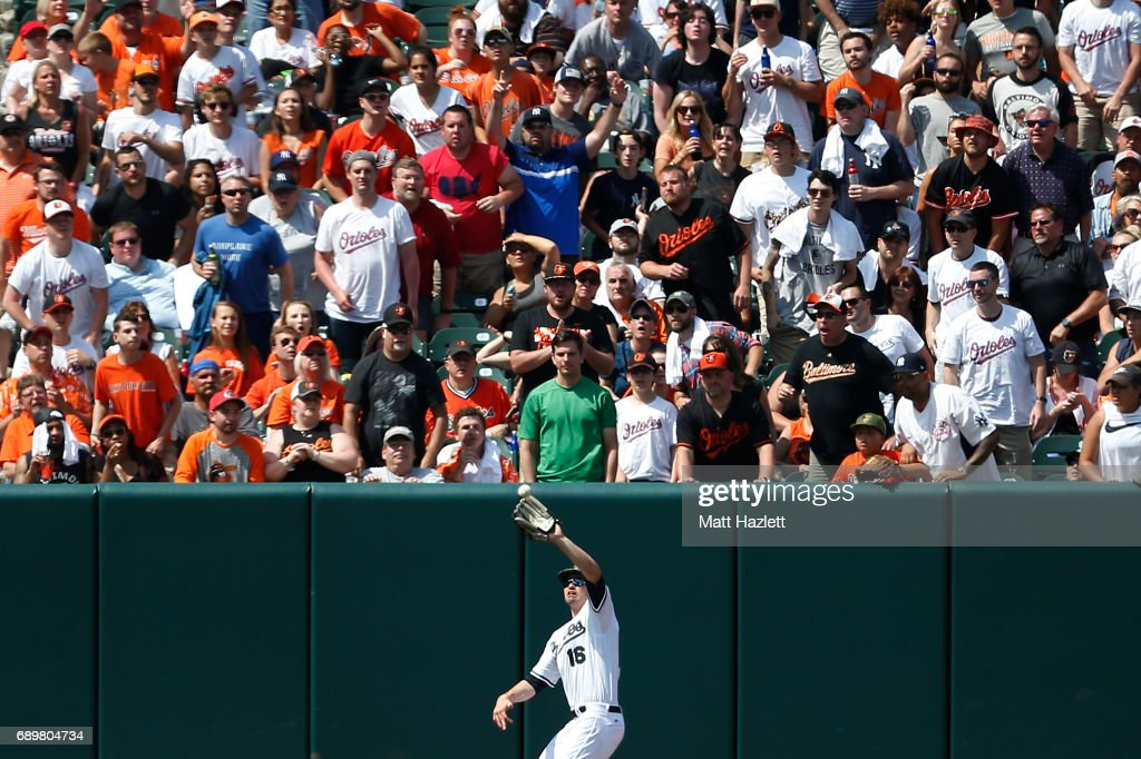 Trey Mancini #16 of the Baltimore Orioles makes a catch off of the bat of Aaron Hicks #31 of the New York Yankees (not pictured) for the second out of the seventh inning at Oriole Park at Camden Yards on May 29, 2017 in Baltimore, Maryland. MLB players across the league are wearing special uniforms to commemorate Memorial Day.