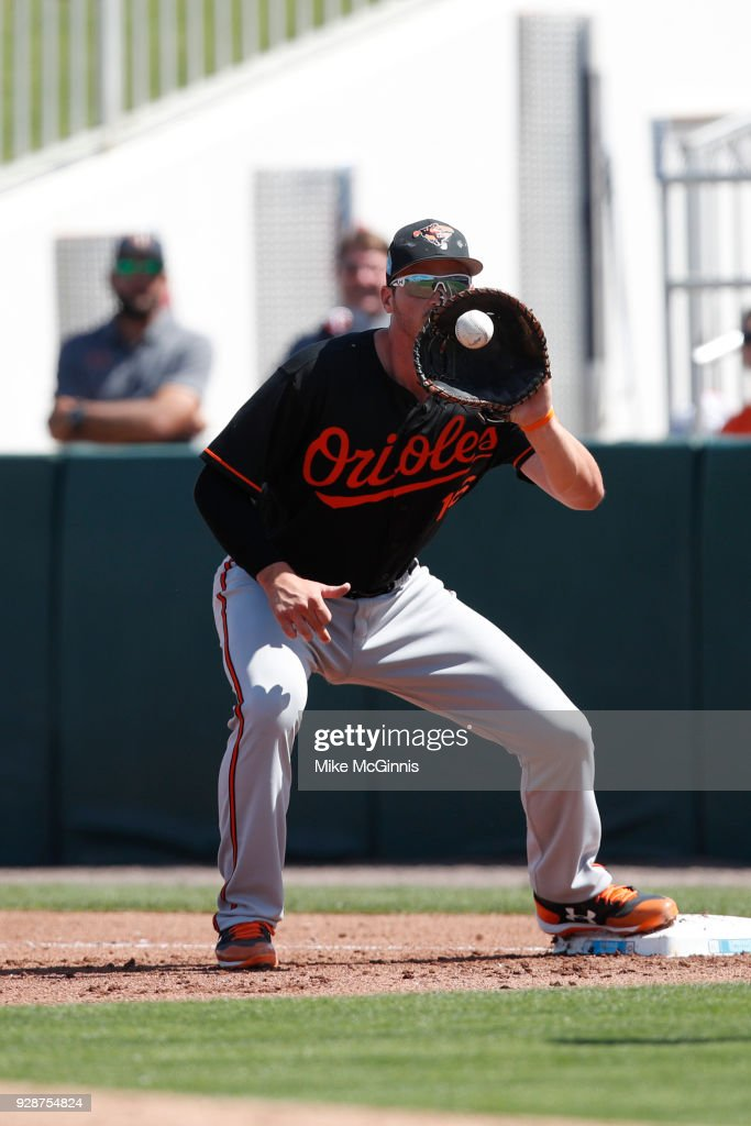 Trey Mancini #16 of the Baltimore Orioles makes the grab at first base for an out during the Spring Training game against the Minnesota Twins at Hammond Stadium on March 06, 2018 in Fort Myers, Florida.