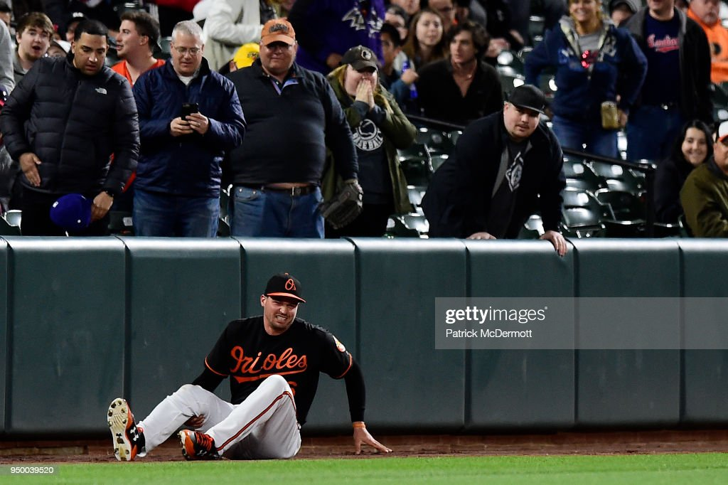 Trey Mancini #16 of the Baltimore Orioles reacts after being injuried in the eighth inning against the Cleveland Indians at Oriole Park at Camden Yards on April 20, 2018 in Baltimore, Maryland. The Orioles defeated the Indians 3-1.