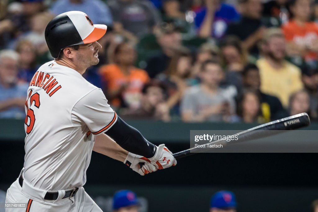 Trey Mancini #16 of the Baltimore Orioles reacts after grounding into a double play against the New York Mets during the sixth inning at Oriole Park at Camden Yards on August 14, 2018 in Baltimore, Maryland.