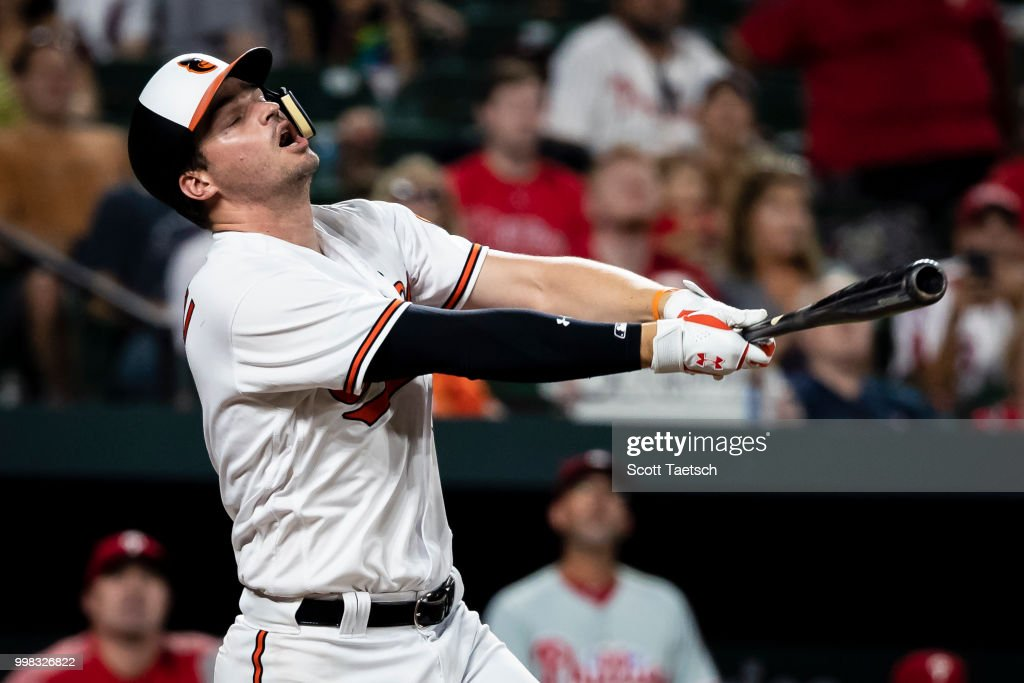 Trey Mancini #16 of the Baltimore Orioles reacts against the Philadelphia Phillies during the ninth inning at Oriole Park at Camden Yards on July 12, 2018 in Baltimore, Maryland.