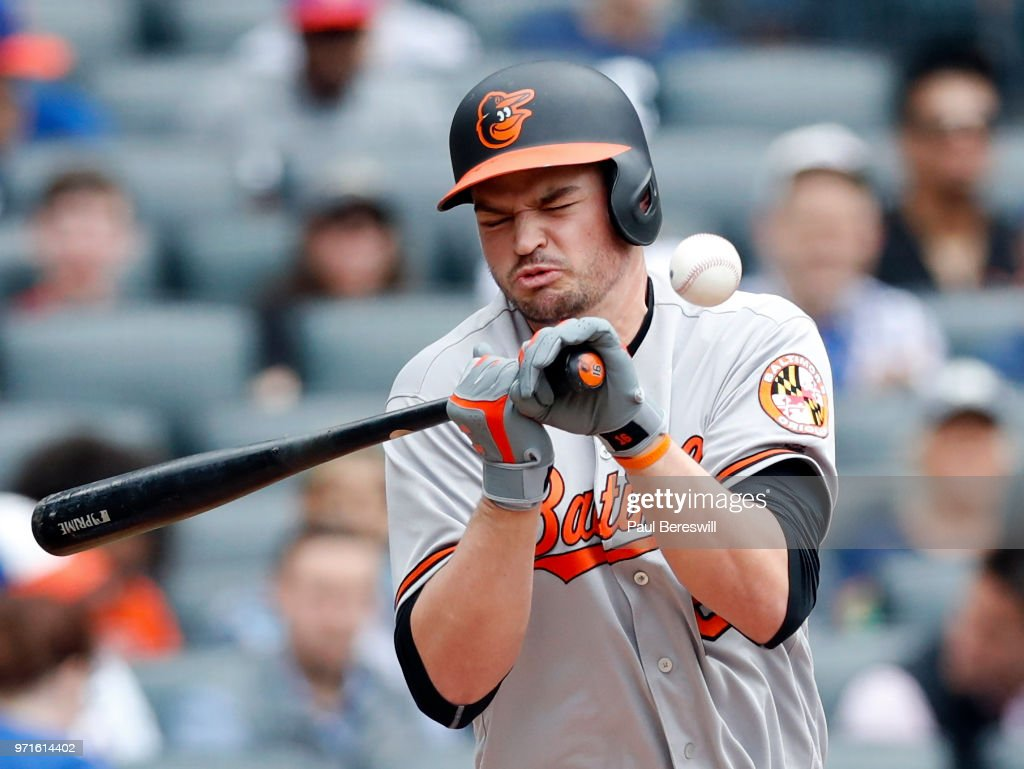 Trey Mancini #16 of the Baltimore Orioles reacts as he is hit in the chest by a pitch as he bats in an interleague MLB baseball game against the New York Mets on June 6, 2018 at CitiField in the Queens borough of New York City. Orioles won 1-0.
