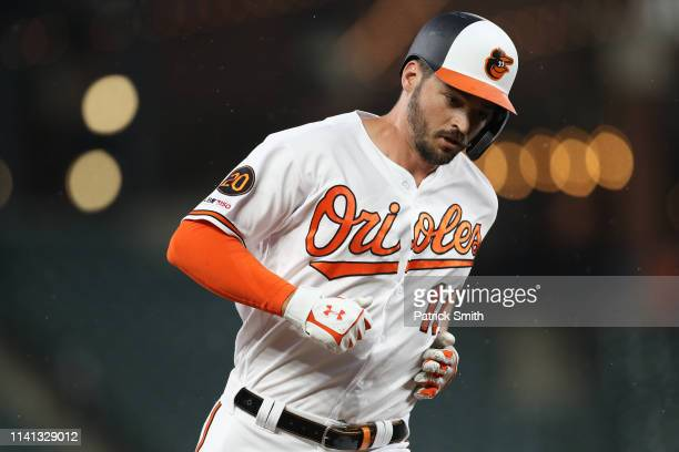 Trey Mancini of the Baltimore Orioles rounds the bases after hitting a home run against the Oakland Athletics during the first inning at Oriole Park...