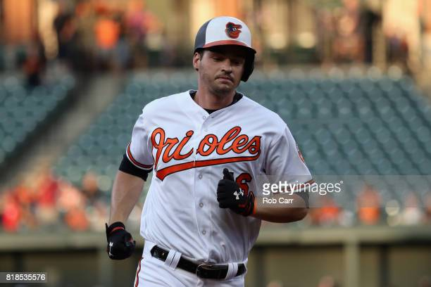 Trey Mancini of the Baltimore Orioles rounds the bases after hitting a two RBI home run against the Texas Rangers in the first inning at Oriole Park...