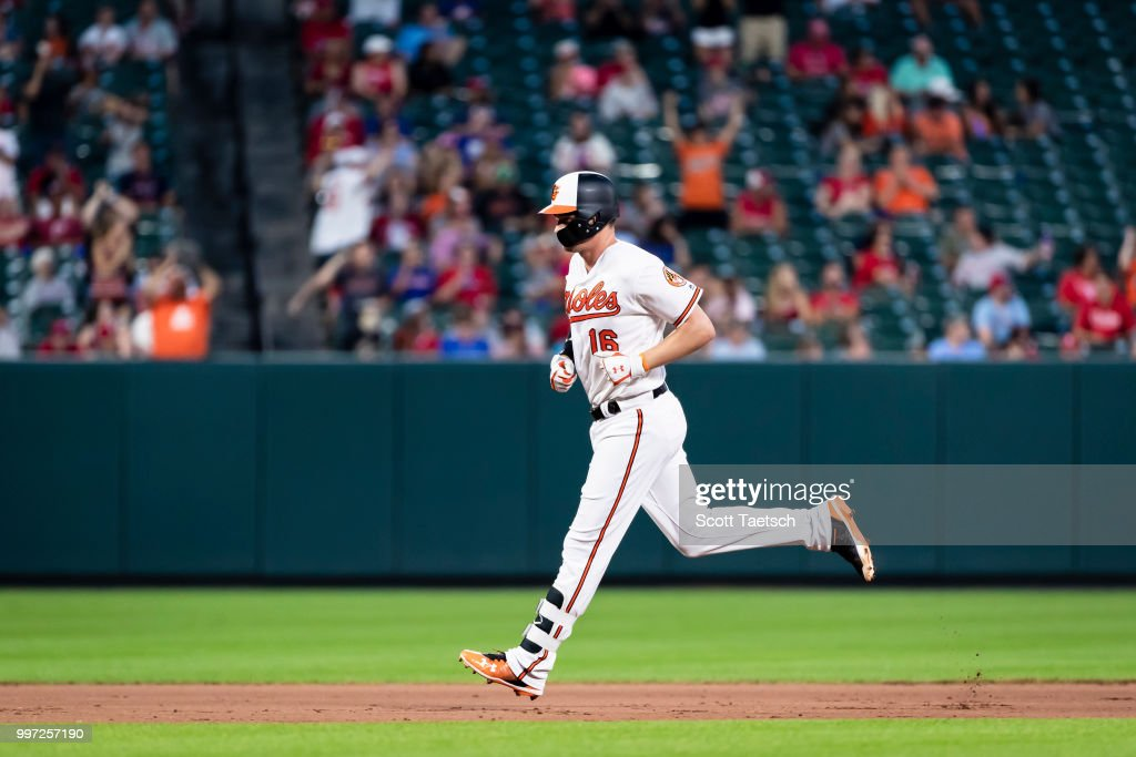 Trey Mancini #16 of the Baltimore Orioles rounds the bases after hitting a two run home run against the Philadelphia Phillies during the seventh inning at Oriole Park at Camden Yards on July 12, 2018 in Baltimore, Maryland.