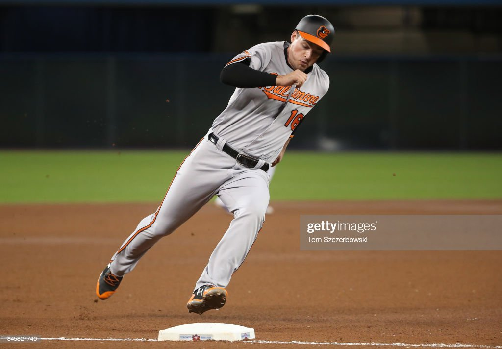 Trey Mancini #16 of the Baltimore Orioles rounds third base as he runs home to score on an RBI single by Caleb Joseph #36 in the seventh inning during MLB game action against the Toronto Blue Jays at Rogers Centre on September 11, 2017 in Toronto, Canada.