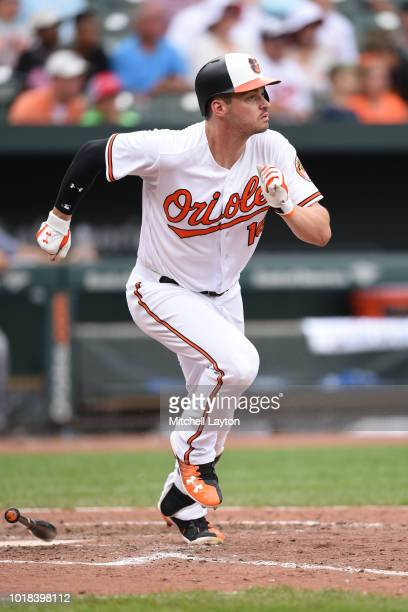 Trey Mancini of the Baltimore Orioles runs to first base during a baseball game against the Tampa Bay Rays at Oriole Park at Camden Yards on July 29...
