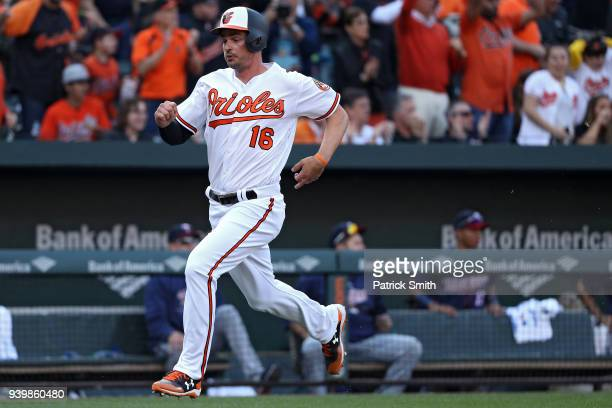 Trey Mancini of the Baltimore Orioles scores against the Minnesota Twins during the seventh inning in their Opening Day game at Oriole Park at Camden...
