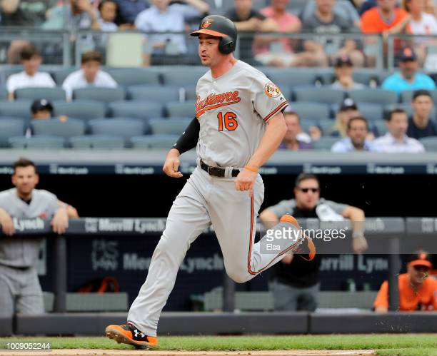 Trey Mancini of the Baltimore Orioles scores in the second inning against the New York Yankees at Yankee Stadium on August 1 2018 in the Bronx...