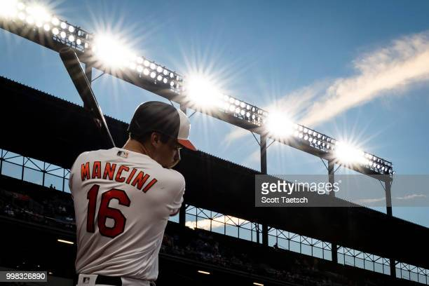 Trey Mancini of the Baltimore Orioles warms up in the batters circle against the Philadelphia Phillies during the seventh inning at Oriole Park at...