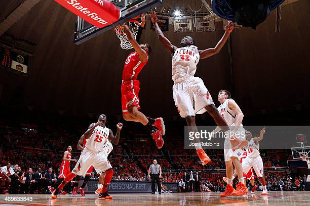Trey McDonald of the Ohio State Buckeyes is fouled from behind by Nnanna Egwu of the Illinois Fighting Illini during the game at State Farm Center on...