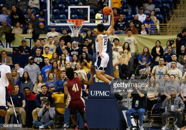 Trey McGowens of the Pittsburgh Panthers attempt a dunk against Terance Mann of the Florida State Seminoles at Petersen Events Center on January 14...
