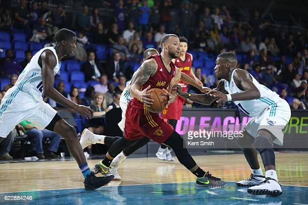 Trey MckinneyJones of the Fort Wayne Mad Ants tries to escape the defense against Mike Anderson the Greensboro Swarm during the game at the The Field...