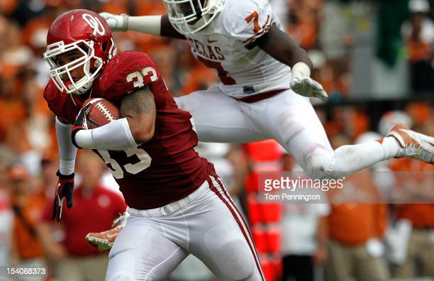 Trey Millard of the Oklahoma Sooners carries the ball for a touchdown against Demarco Cobbs of the Texas Longhorns at Cotton Bowl on October 13 2012...