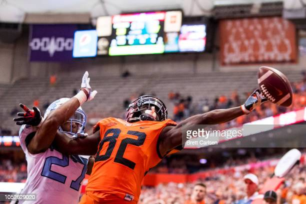 Trey Morrison of the North Carolina Tar Heels breaks up a pass in the end zone intended for Nykeim Johnson of the Syracuse Orange during the fourth...