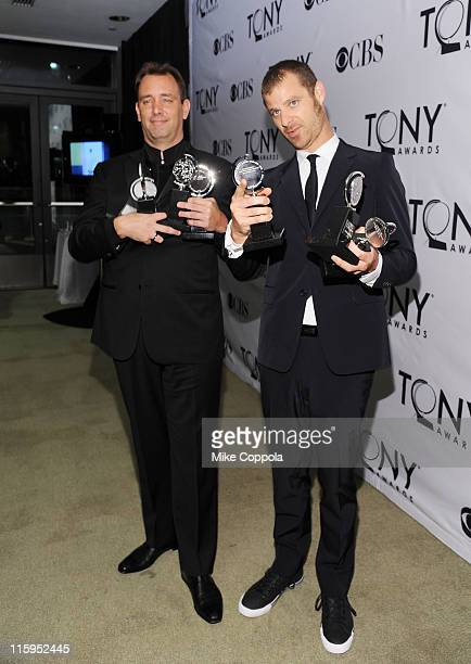 Trey Parker and Matt Stone pose with the award for Best Musical in the press room during the 65th Annual Tony Awards at the The Jewish Community...