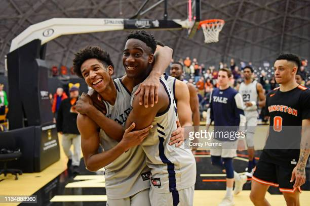 Trey Phills and Miye Oni of the Yale Bulldogs celebrate the win against the Princeton Tigers after the game at L Stockwell Jadwin Gymnasium on March...