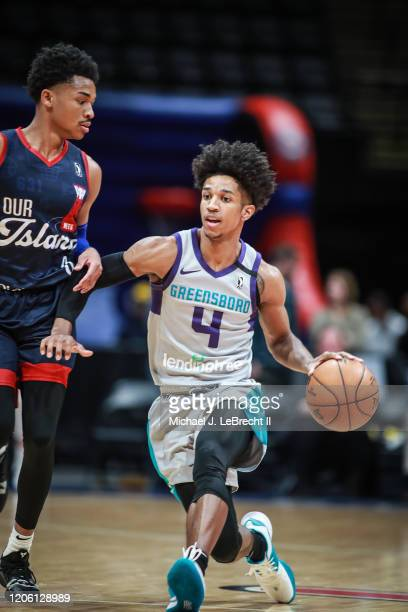 Trey Phills of the Greensboro Swarm drives the ball against the Long Island Nets during an NBA G-League game on March 8, 2020 at Nassau Veterans...