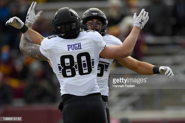 Trey Pugh of the Northwestern Wildcats congratulates teammate Isaiah Bowser on scoring a touchdown against the Minnesota Golden Gophers during the...
