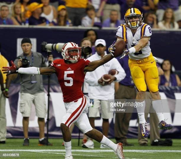Trey Quinn of the LSU Tigers has the pass broken up by Darius Hillary of the Wisconsin Badgers at NRG Stadium on August 30 2014 in Houston Texas