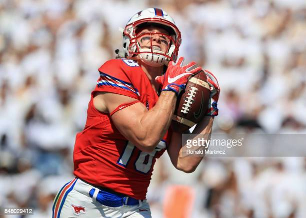 Trey Quinn of the Southern Methodist Mustangs makes a touchdown pass reception in the first half against the TCU Horned Frogs at Amon G Carter...
