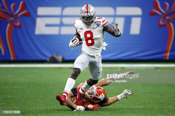 Trey Sermon of the Ohio State Buckeyes carries the ball against Lannden Zanders of the Clemson Tigers in the first quarter during the College...