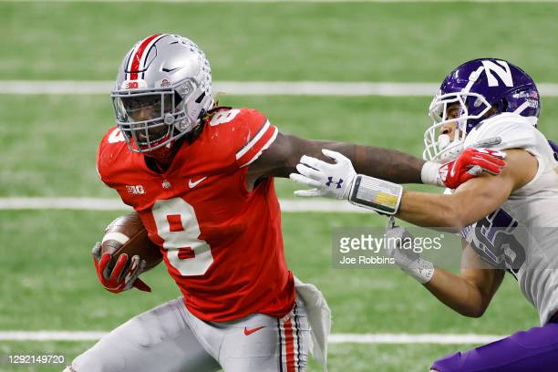 Trey Sermon of the Ohio State Buckeyes runs the ball in the fourth quarter against the Northwestern Wildcats during the Big Ten Championship at Lucas...