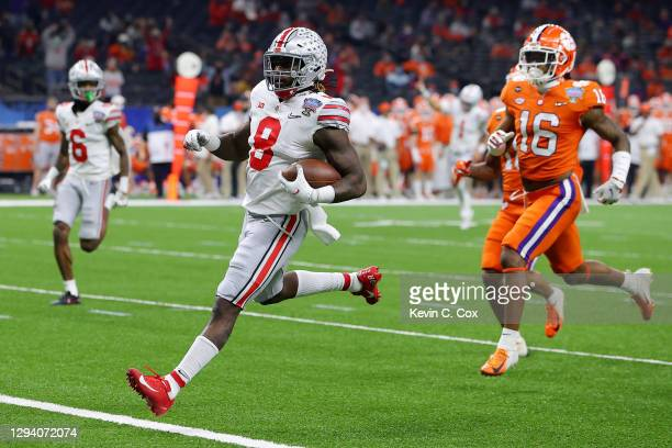 Trey Sermon of the Ohio State Buckeyes scores a touchdown against Ray Thornton III of the Clemson Tigers in the first quarter during the College...