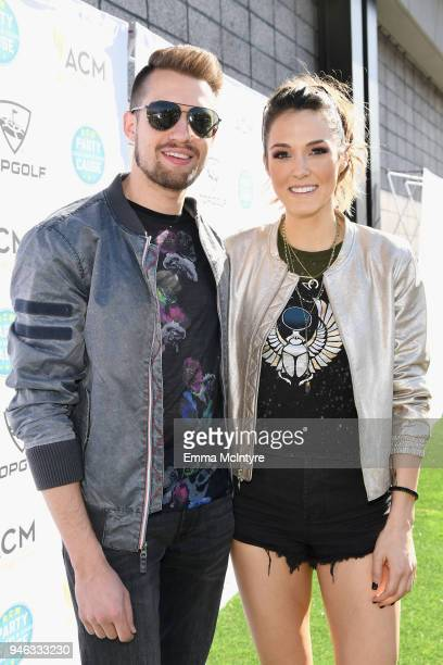 Trey Smith and Jennifer Fiedler of Smithfield attend the ACM Lifting Lives TOPGOLF TeeOff at Topgolf Las Vegas on April 14 2018 in Las Vegas Nevada