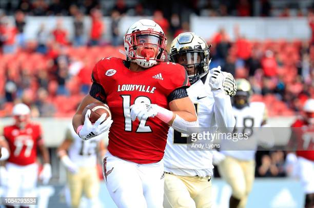 Trey Smith of the Louisville Cardinals runs for a touchdown against the Wake Forest Demon Deacons on October 27 2018 in Louisville Kentucky