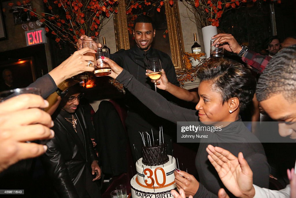 Trey Songz (C) amd April Tucker (R) attend Trey Songz 30th Birthday Celebration at The Lion on December 1, 2014 in New York City.