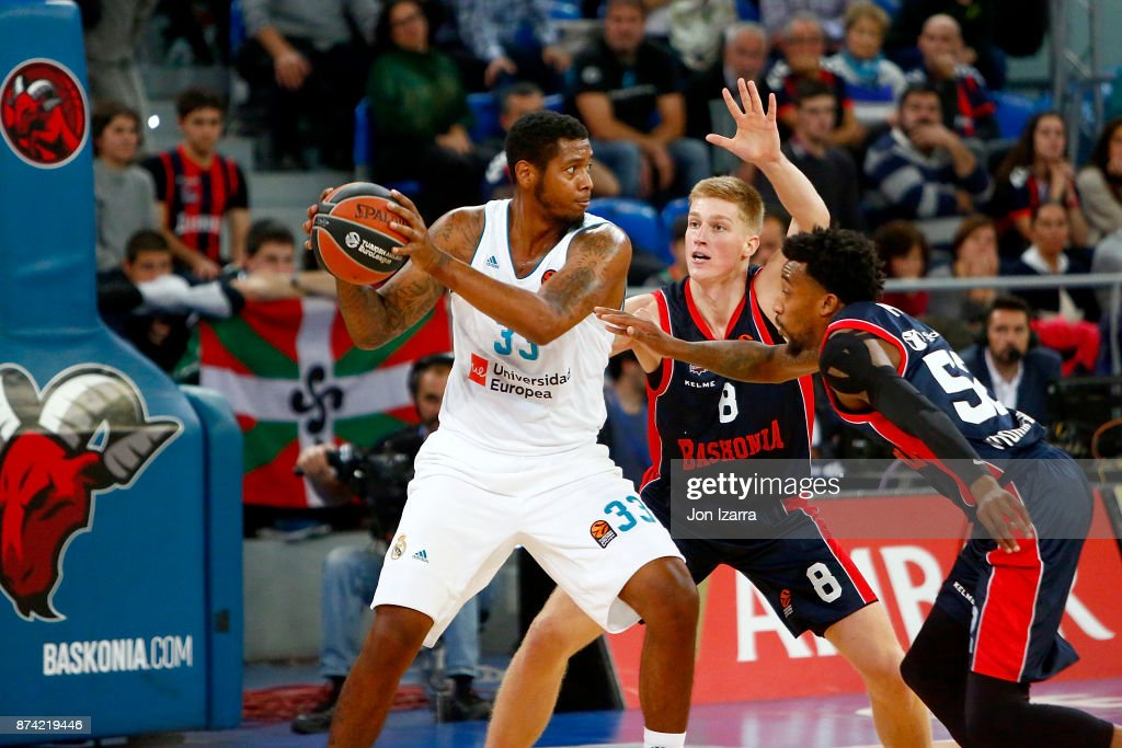 Trey Thompkins, #33 of Real Madrid competes with Rinalds Malmanis, #8 of Baskonia Vitoria Gasteiz during the 2017/2018 Turkish Airlines EuroLeague Regular Season Round 7 game between Baskonia Vitoria Gasteiz and Real Madrid at Fernando Buesa Arena on November 14, 2017 in Vitoria-Gasteiz, Spain.